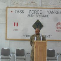 Presiding over a multinational 9/11 ceremony at a small camp in Afghanistan